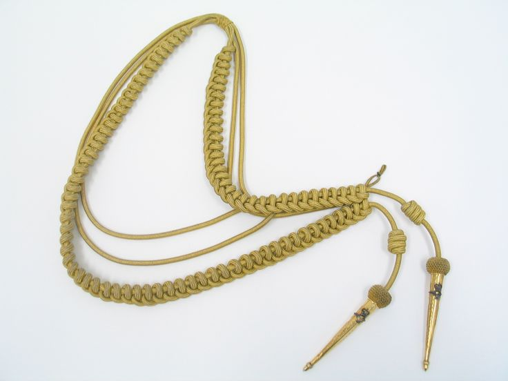 Aiguillettes originally attached to Service Dress jacket worn by Air Vice Marshal Sir Richard Bolt. Gold braid with metal tips. Tips feature Queen's crown and eagle badge.From the collection of the Air Force Museum of New Zealand.