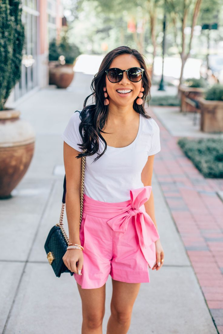 COLOR & CHIC | Summer outfit idea: pink tie-waist shorts with a white tee and sequin drop earrings