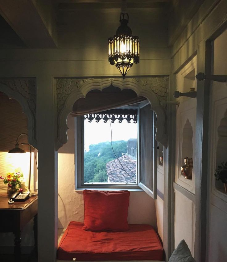 Cozy room with a view in India.  I love that sandstone color with red. Gorgeous. Repost @gaboushk
