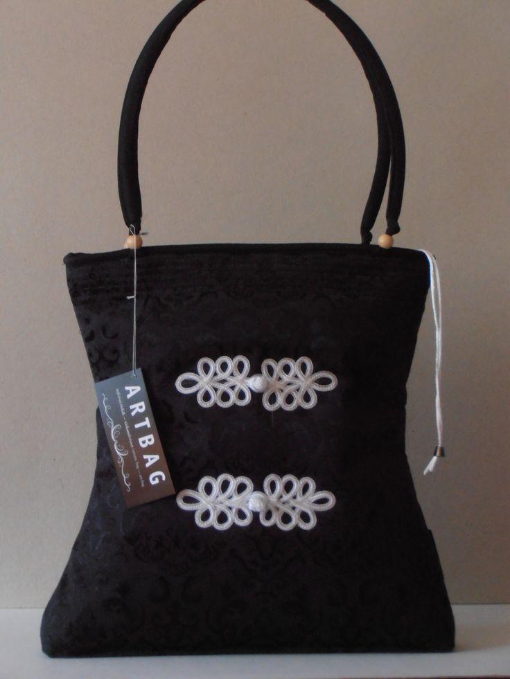 Taffeta bag with cord decoration