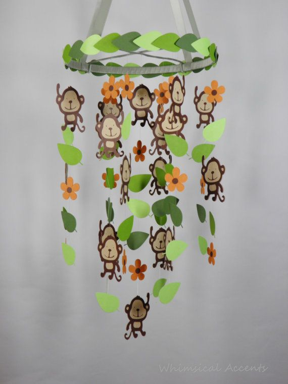 Monkey Jungle Baby Mobile with Leaves and Flowers and by whimsicalaccents on Etsy. Perfect for your jungle themed nursery.