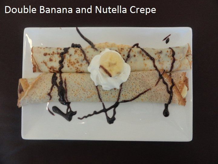 Plated with two crepes: Banana and Nutella Crepe with chocolate sauce and fresh whipped cream at Savoury and Sweet Restaurant Niagara Falls Ontario 3770 Bridgewater street