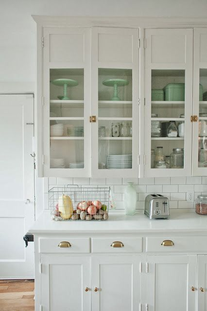 brass hardware on vintage cabinets