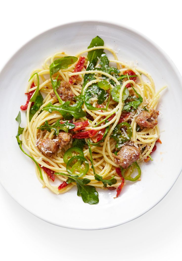 Hearty sausage pairs well with greens; and while broccoli (and its more strongly flavored cousin broccoli rabe) is the usual, this recipe swaps in slightly spiced arugula. When you toss the greens with hot spaghetti, the leaves wilt, so it's easy to twirl a forkful and get the perfect bite: salty sausage, peppery arugula, al dente pasta plus a little kick from thinly sliced jalapeño.