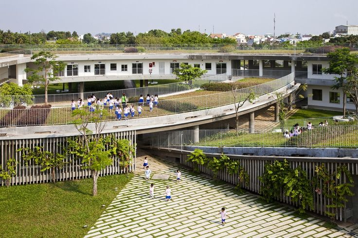 Farming Kindergarten / Vo Trong Nghia Architects, green roof, entry, play area, kids