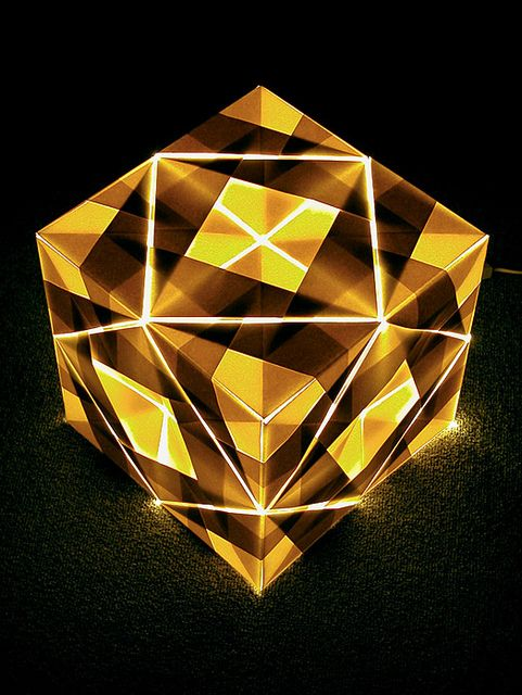 Origami Lamp    Diagram by Mitsunobu Sonobe.  Folded by me.  Sonobe Variation.  24 Modules