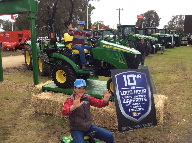 Jack Miller (below) and Tom Sheather (on the tractor above) from Corryong giving us 10 to celebrate the launch of the John Deere ten year or 1,000 hour warranty (on compact and 5 series tractors) at the Hutcheon and Pearce site at Henty Machinery Field Days. They are teenagers now, but will be in their mid 20's by the time the warranty runs out!