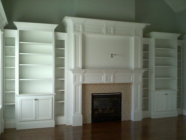 amazing built ins that could be constructed with pieces from Ikea. Just add molding to dress up. Love the varying heights!