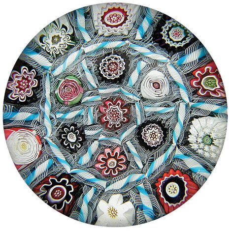 "Antique Clichy glass paperweight, ca. 1850. The design, with its sectioned-off millefiori canes, is known as a ""chequer"" pattern."