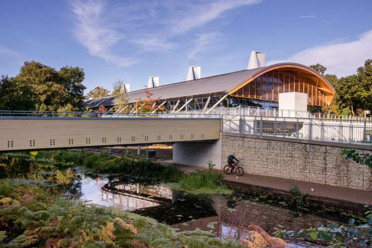 Living Planet Centre, WWF-UK Headquarters The building from the southeast, with the Basingstoke Canal in the foreground and the pedestrian bridge to the town centre at left, © Richard Stonehouse