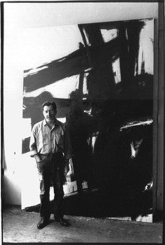 American artist Franz Kline (1910-1962) in his studio photographed by John Cohen. See black n white card below which looks similar.