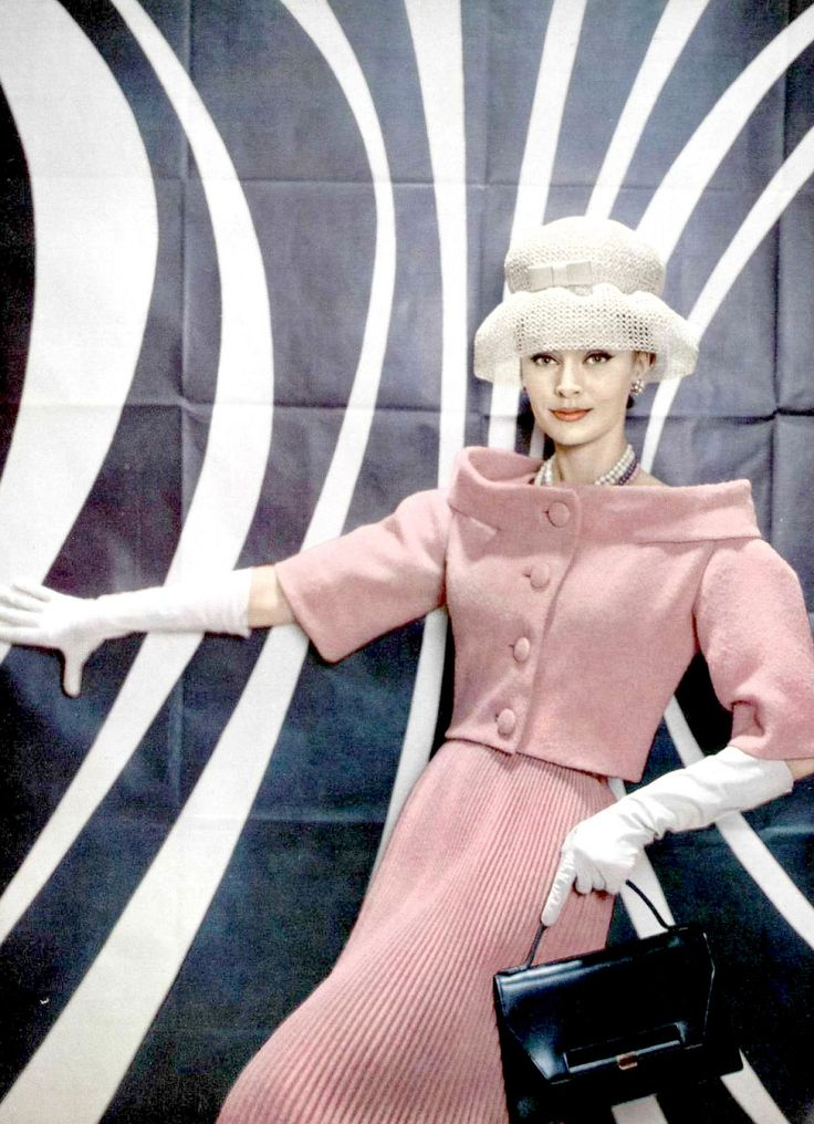 Pink wool suit with tiny pleated skirt and short jacket with standing collar by Pierre Cardin, photo by Guy Arsac, 1959