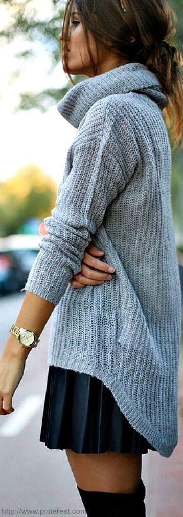 Gray sweater & black pleated skirt.