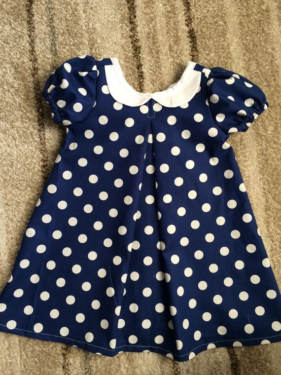 We love this adorable dress. Peter Pan collar in the front but that back!!! How adorable is that bow. Perfect for your little lady to hunt those