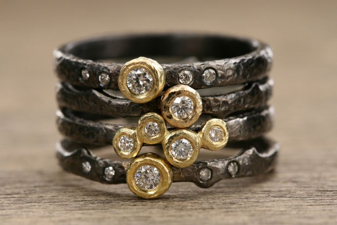 Black rhodium-plated sterling silver rings with 18k yellow gold bezels with diamonds; $290–$450; Yasuko Azuma Jewelry