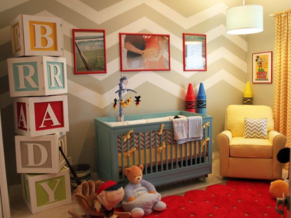 Love the letter blocks in this colorful boy's nursery! Would be nifty if they could be storage of some sort