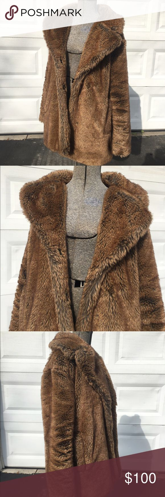 Brown faux fur coat Brown large collar faux fur coat purchased at a boutique in London. This jacket has been very worn so please see images. Jackets & Coats