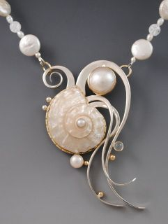 Necklace - by Barbara Umbel Jewelry Design. Shell, in 14k gold and sterling silver with pearls.