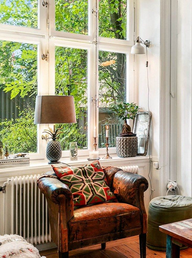 apartment in Stockholm, where the atmosphere is that of an English Club mixed with an industrial touch