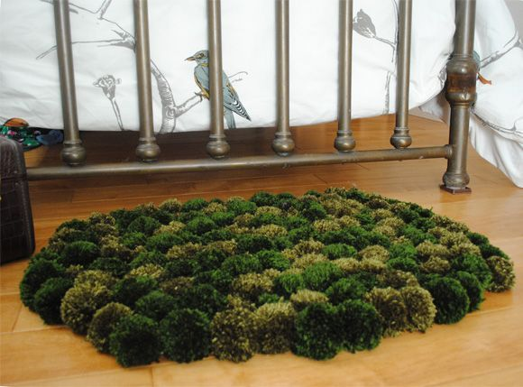 DIY PomPom rug that looks like tufts of moss! Possible decor for Joss's Alice in Wonderland/Through the Looking Glass themed Big Girl room #DisneyAlice