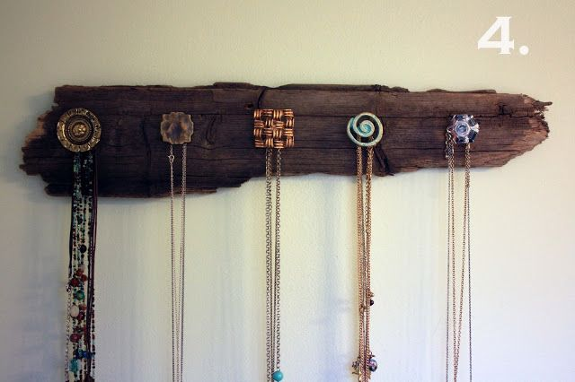 Screw Cheap Furniture Knobs Into Wood for a Necklace Holder. or for our keys!