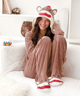 Get in a playful mood with Women's Sock Monkey Loungewear. Cozy pieces are inspired by the popular toy, and you can wear them all season. The hoodie Top has an open henley neckline. A sock monkey face, complete with pom-pom hat, decorates the hood.
