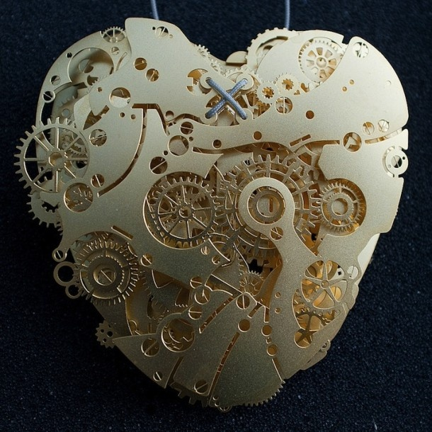 Paper heart by Frank Tjepkema - nice! so much detail and it all still stands out in white - nicely done. Note: The original pin's web site link did not work. This one does.