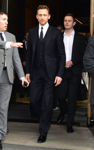 Oh. My. Gosh. The dapperness! - Tom Hiddleston Leaving The Trump Soho Hotel He's so taaaaalllll