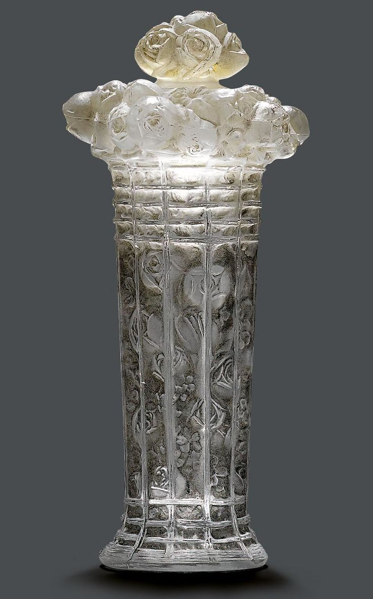 """RENE LALIQUE  """"PANIER DE ROSES"""" BOTTLE, circa 1930.  Mould pressed colourless glass with a black patina and rose decoration."""