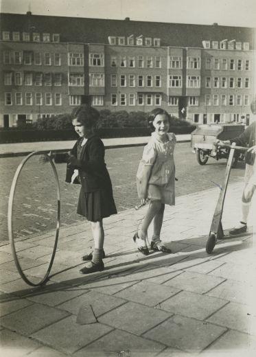 Anne Frank and Sanne Ledermann  Photo of Anne Frank and her friend Sanne (left) on the Merwedeplein. Amsterdam, 1935.