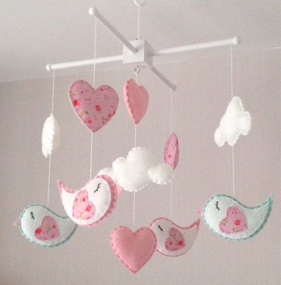Clouds, birds and pink hearts baby crib mobile. An ideal gift for a new babys nursery or for room decor in an older childs bedroom.  This mobile