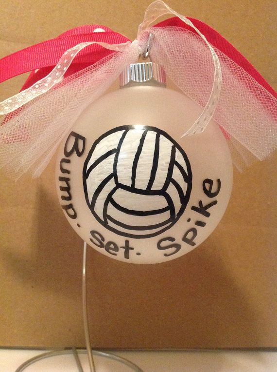 This is a custom painted Volleyball ornament. It is painted on a 4 frosted glass ornament. Personalization can be added to the back and ribbon can be made to match school colors. Simply specify these in the notes when ordering. Each is individually boxed for easy gift giving. Turn around is typically 24 hours and ships priority 1-3 days usps. Can customize saying also.
