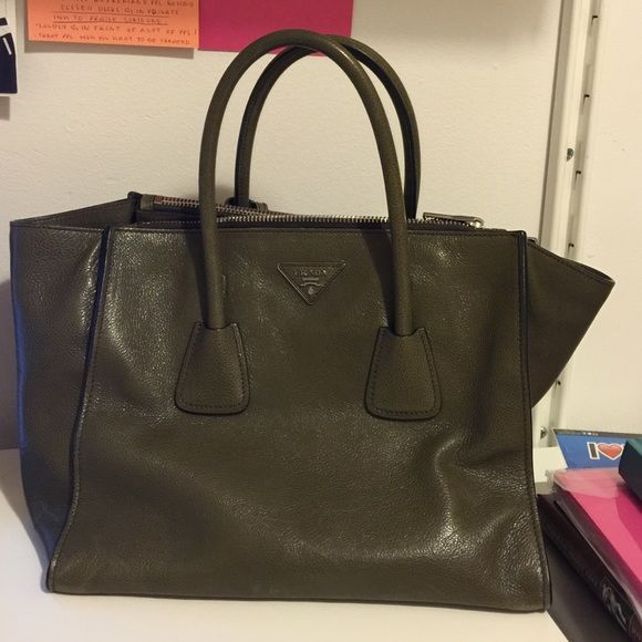 Authentic Prada Handbag Authentic Prada Handbag. Only used 3 times and in absolutely perfect condition. This was a gift to me that I just don't use or need and is so beautiful it needs a home! The perfect neutral color for all outfits. Works beautifully in summer and winter. Prada Bags Totes