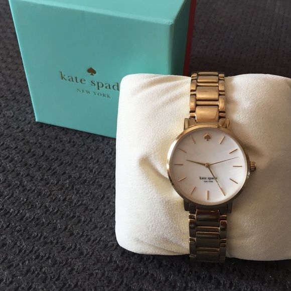 Kate Spade Gold watch white face gold marks/hands Beautiful watch in great condition! Needs a new battery kate spade Accessories Watches