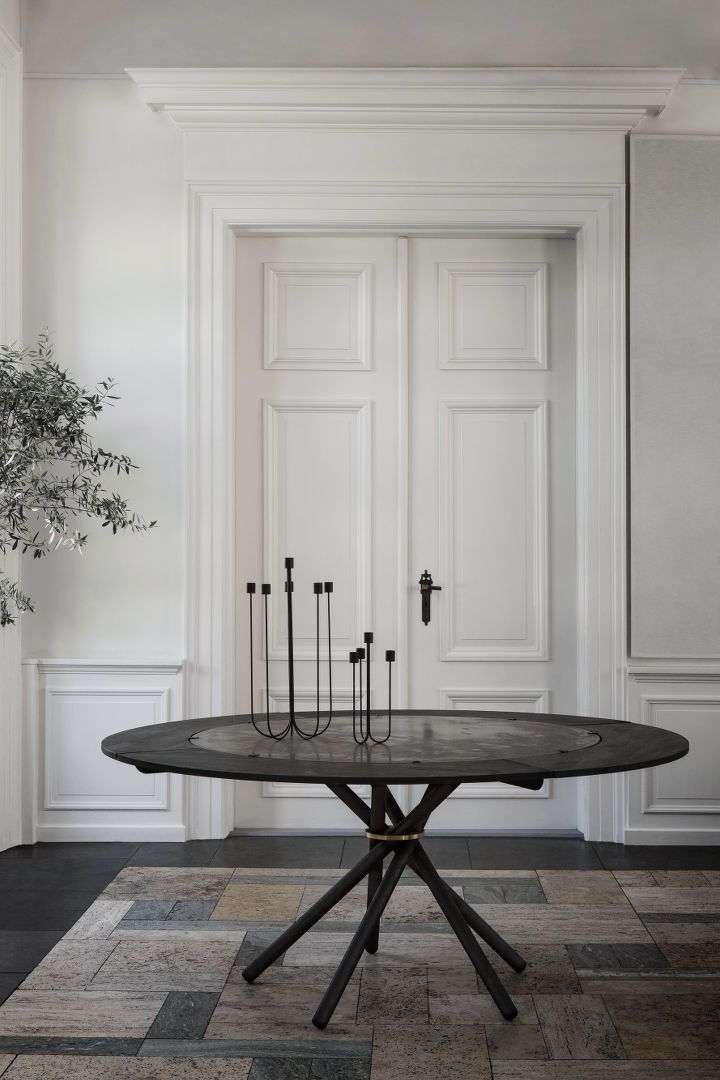 E4 - Dining Table with extra leaves.  Candelabra in bent steel for 4 and 6 candles. #diningtable #candelabra #concretetable #blackstainedoak #leaves #extraleaves #interior #interiordesign #inspiration #danishdesign