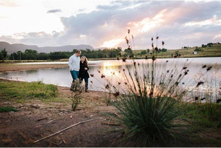 Elle & Ben walking along waters edge