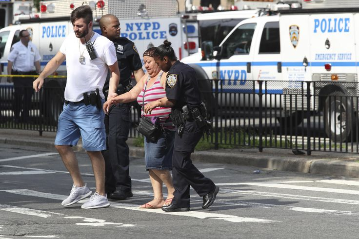 A man pulled a rifle from under his white lab coat and opened fire inside a Bronx hospital Friday, killing at least one person and wounding others before apparently taking his own life, authorities said.