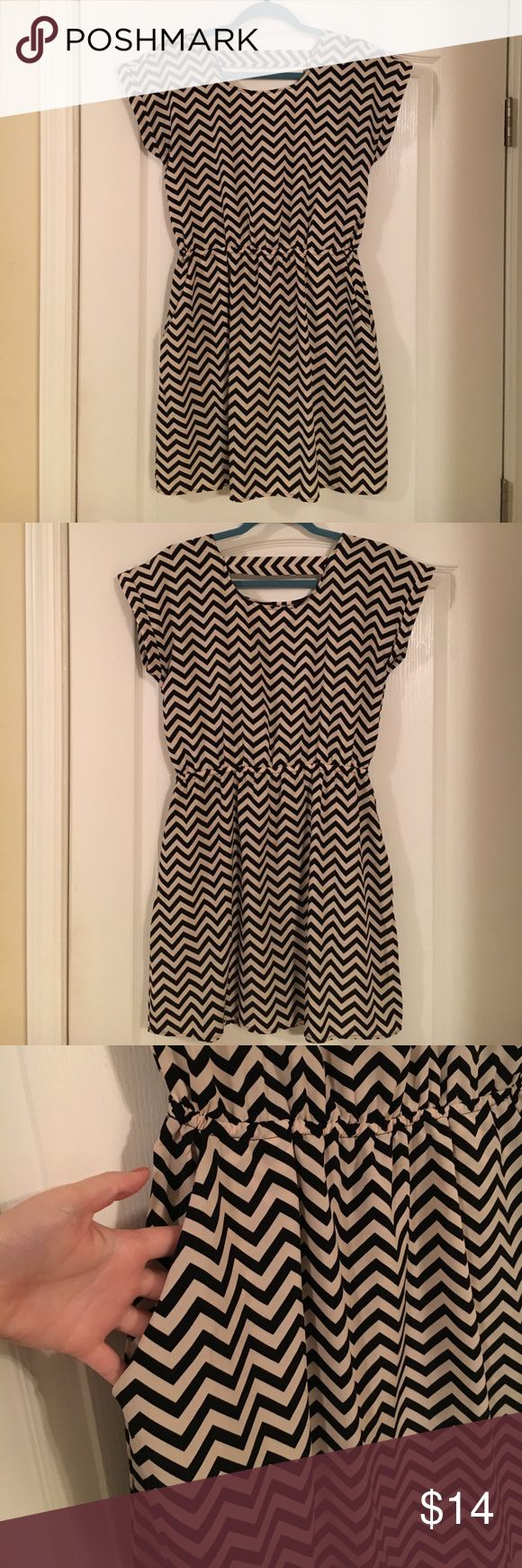 Black & white chevron dress with pockets Black and white chevron dress from Target. It has pockets and is made of a silky, flattering material. Worn once and in excellent condition. Dress it up or dress it down. This cute mini is versatile and great for any occasion! Dresses Mini
