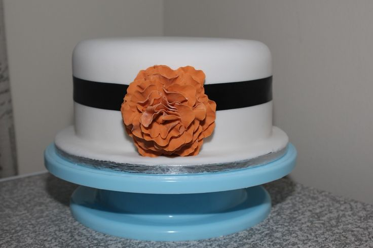 Burnt orange flower fondant wedding cake