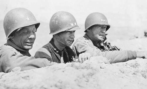 Theodore Roosevelt Jr. Terry Allen and George Patton observing the field near El Guettar Tunisia March 1943.