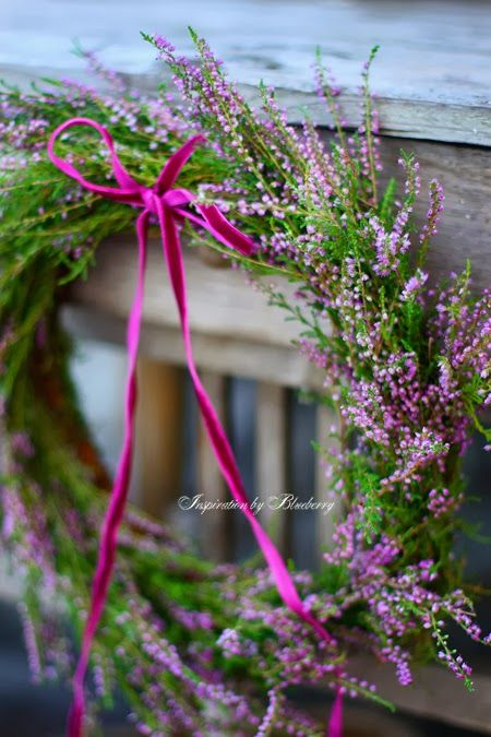 Green moss and lavender grapevine wreath with thin purple velvet ribbon