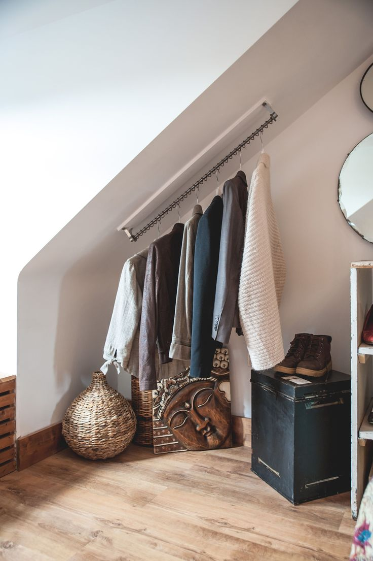Small attic bedrooms can seem even smaller with built in wardrobes. Try an  open closet