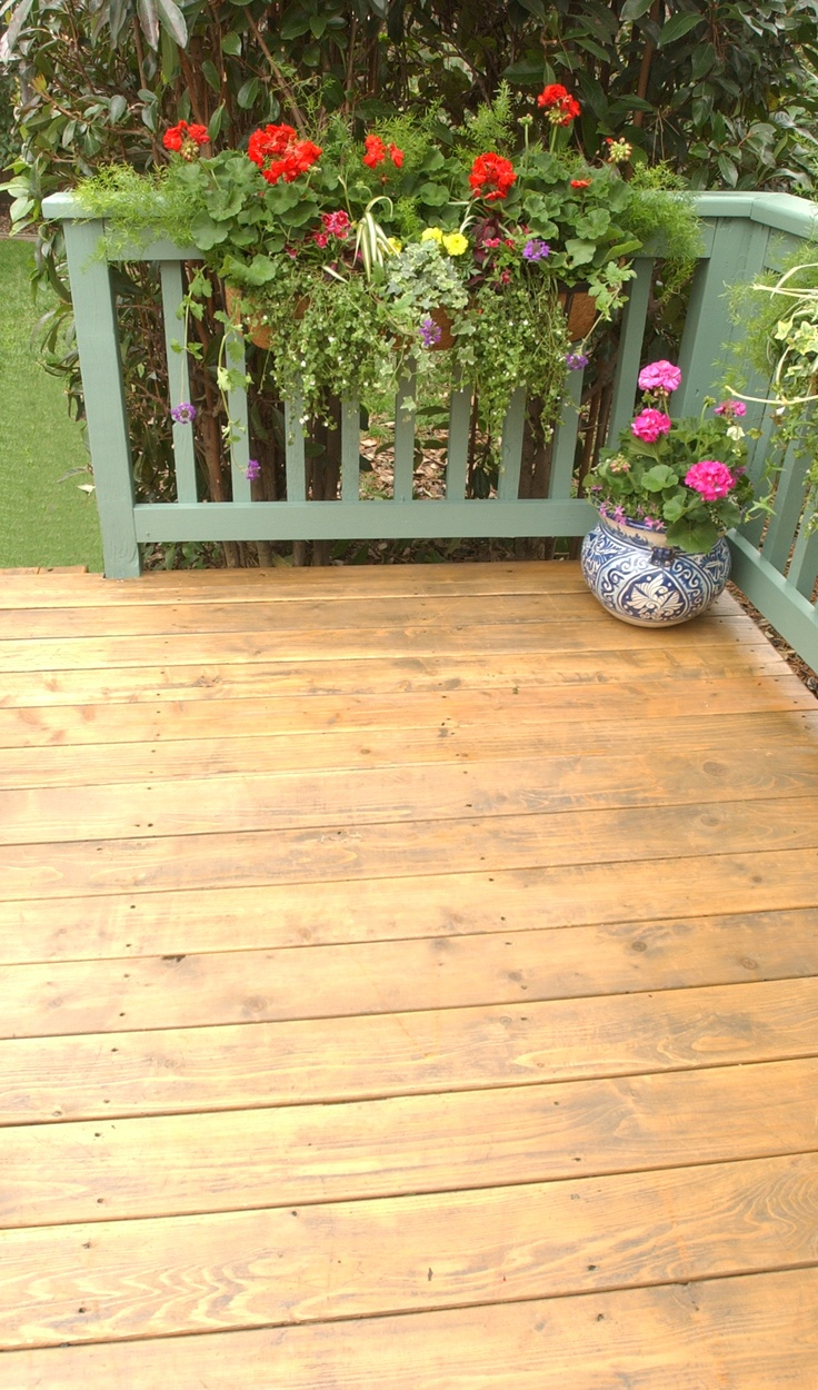 On the deck we used Thompson's Water Seal Advanced Wood Protector in Sheer Honey Gold; on the railings, we used Thompson's Water Seal Deck & House Solid Latex Stain in Spring Leaf.
