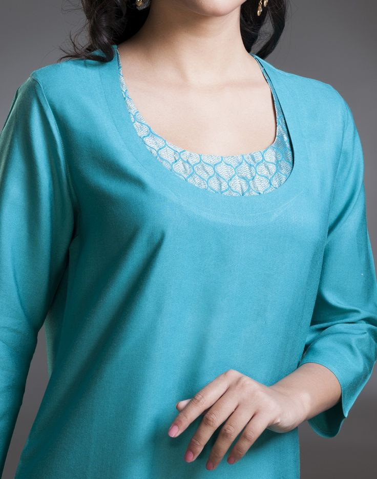 Stylise yourself with this long kurta made using tussar silk and cotton blend. The brocade work accentuates the look of the kurta.  Pair it with our range of churidars to create your own style.   Tussar Cotton Blend Scoop Neck 3Q Sleeves Dry Clean Only