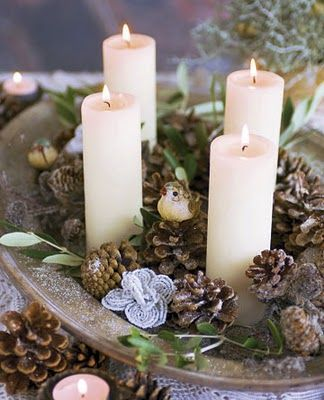 A tray filled with candles, greenery and pine cones. A part of a tablescape @  http://goodideasforyou.com/mix-a-match/2181-diy-pine-cones-decoration.html