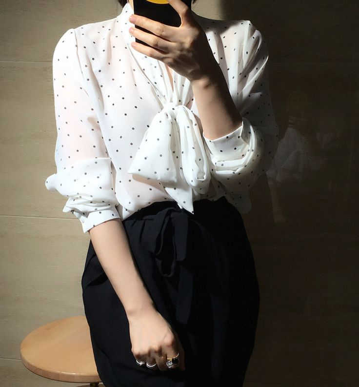 Here is a classic style for those who appreciate timeless fashion. Tailored in chiffon fabric with black polka dot print, this blouse features a shawl-like neckline with a tie that could be wrapped up