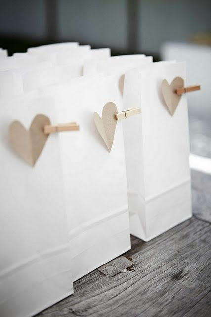simple. Paper hearts on white bags with clothespins...would be great for #wedding or #shower favors