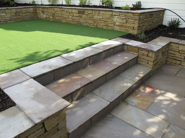 Split level low maintenance garden scheme with natural for Split level garden designs