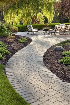 A patio design may include brick walkways as part of the outdoor living design.