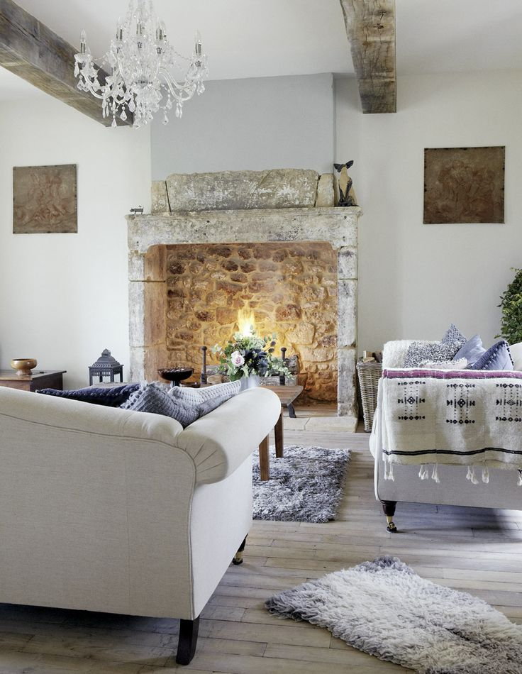The walls and beamed ceilings are original and the fireplaces and stone floors were reconstructed to blend in with the original features.